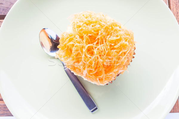 Gold egg yolk thread cup cake with stainless spoon Stock photo © punsayaporn