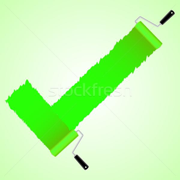 Green check symbol from paint roller brush Stock photo © punsayaporn