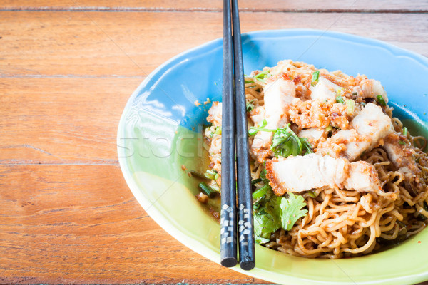 Stir fried spicy noodles with crispy pork and chopstick Stock photo © punsayaporn