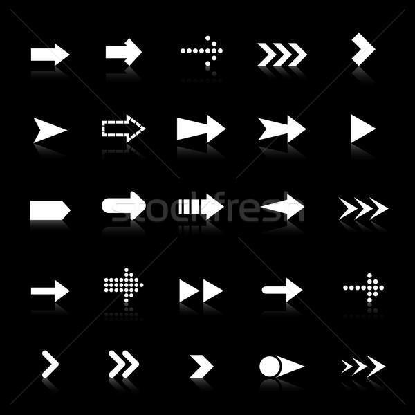 Arrow icons with reflect on black background Stock photo © punsayaporn