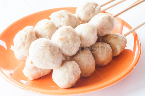 Stock photo: Mini pork balls in orange dish on clean table