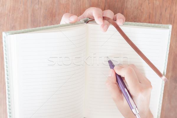 Woman pay attention of writing Stock photo © punsayaporn
