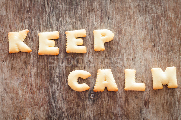 Keep calm alphabet biscuit on wooden table Stock photo © punsayaporn