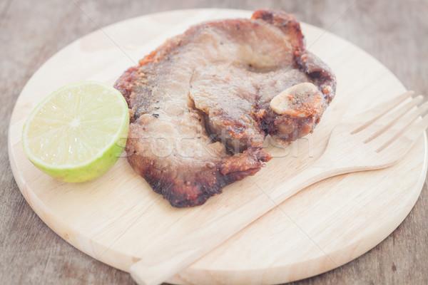 Disznóhús steak fából készült tányér stock fotó Stock fotó © punsayaporn