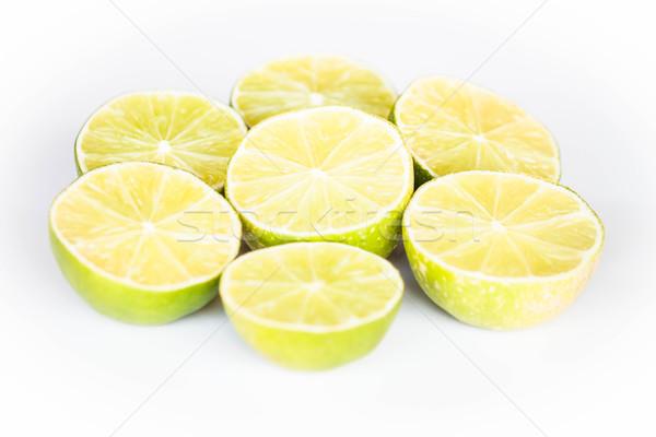 Half portion lime slice on white background Stock photo © punsayaporn