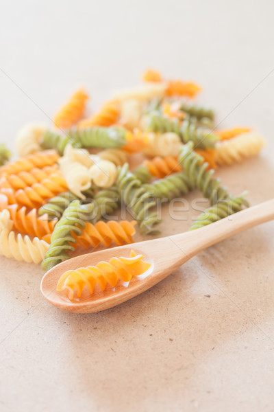 Raw fusilli pasta with wooden spoon Stock photo © punsayaporn