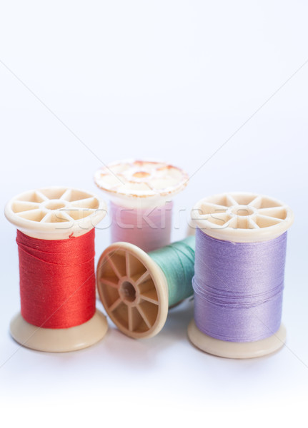 Vintage grunge colorful thread spool on white background Stock photo © punsayaporn