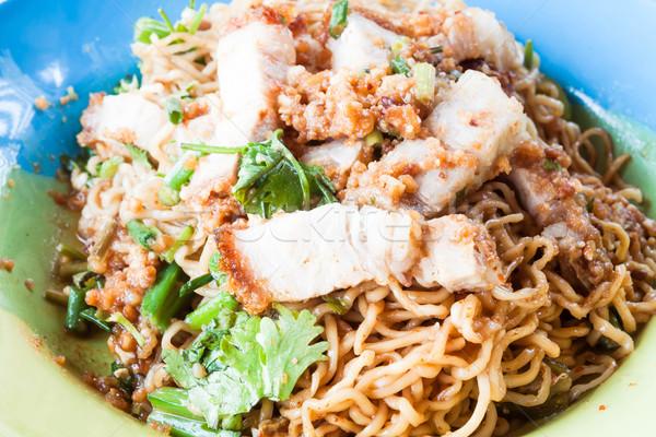 Stir fried spicy noodles with crispy pork Stock photo © punsayaporn