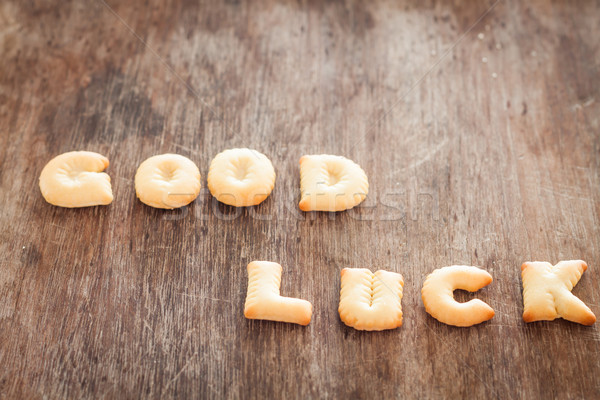 Good luck alphabet biscuit on wooden table Stock photo © punsayaporn