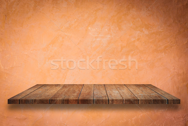 Empty perspective top wooden shelf on orange wall Stock photo © punsayaporn
