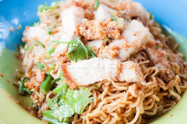 Close up crispy pork on stir fried spicy noodles Stock photo © punsayaporn