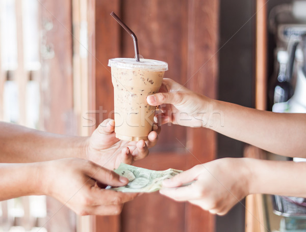 Giving money for freshly brewed coffee Stock photo © punsayaporn
