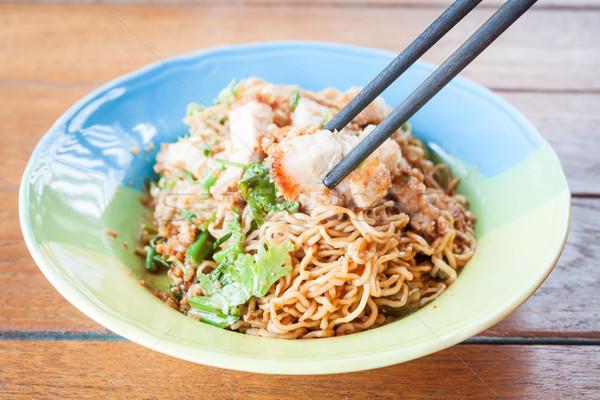 Wood chopstick holding a crispy  barbecue pork Stock photo © punsayaporn