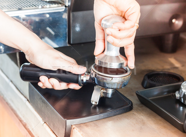 Barista with tamper for making espresso with vintage style Stock photo © punsayaporn
