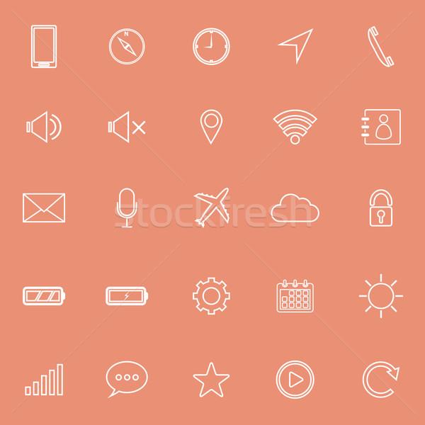 Mobile phone line icons on orange background Stock photo © punsayaporn