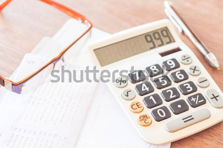 Calculator, notepad and pen on grey background Stock photo © punsayaporn