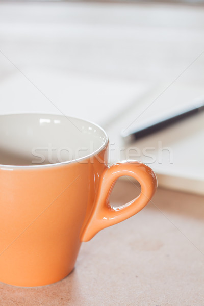 Stock photo: Pen and spiral notebook with coffee cup