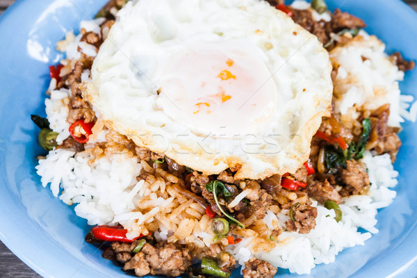 Closeup fried egg of rice stir fried pork and basil Stock photo © punsayaporn