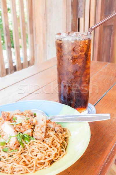 Stock photo: Simple meal with stir fried spicy noodles and cola