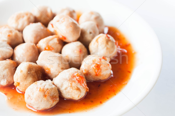 Stock photo: Mini pork balls in orange dish on clean table