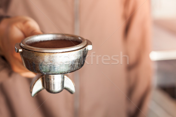 Woman's hand holding coffee grind in group with vintage style Stock photo © punsayaporn