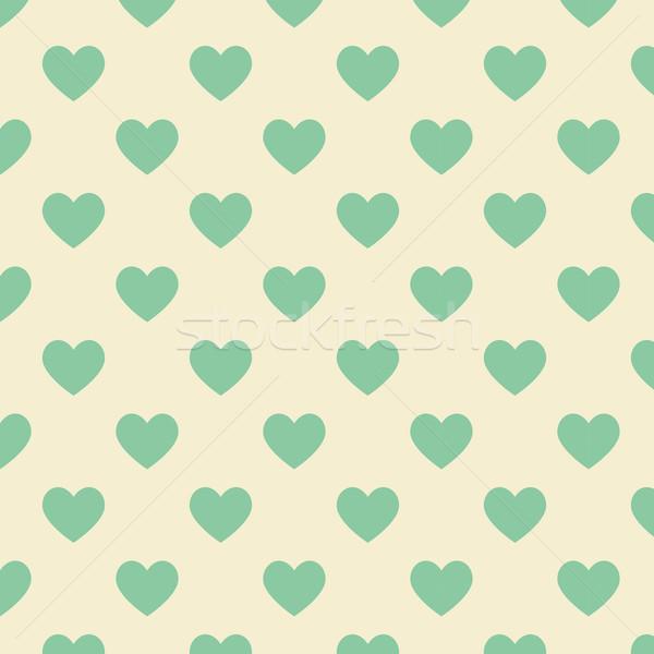 Seamless polka dot yellow pattern with green heart Stock photo © punsayaporn