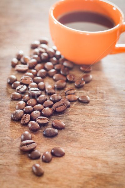 Coffee beans with coffee cup on wooden table Stock photo © punsayaporn