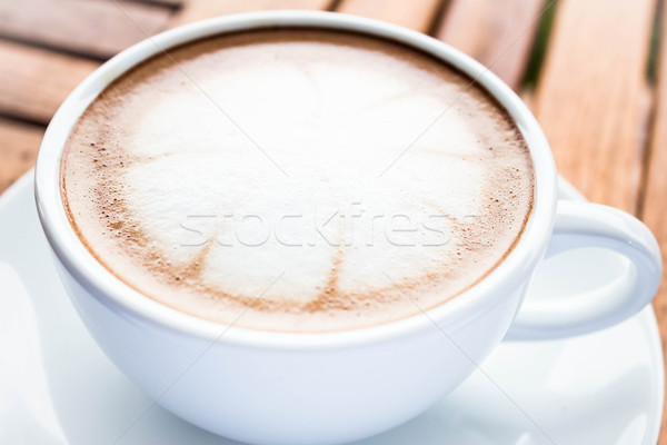 Serving cup of hot cafe mocha on wooden table Stock photo © punsayaporn