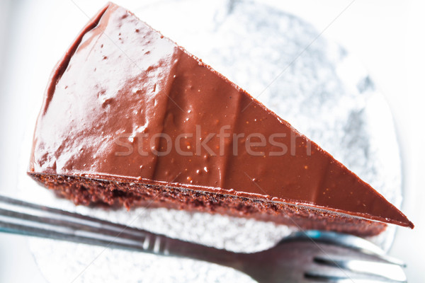 Top view of chocolate cake with spoon and fork Stock photo © punsayaporn