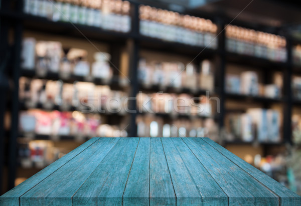 Blue tabletop wooden with blurred cafe background Stock photo © punsayaporn