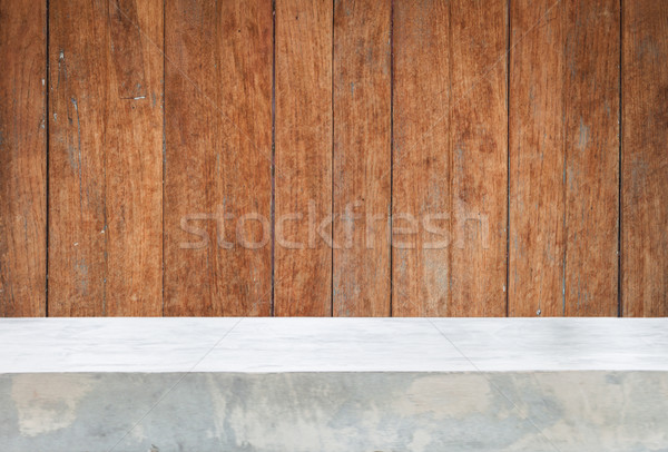 Concrete table top with old wooden background Stock photo © punsayaporn