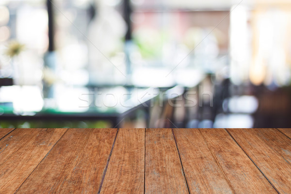 Empty wooden table and blurred cafe background Stock photo © punsayaporn