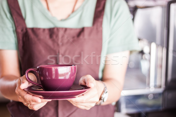 Shop owner serving freshly brewed coffee  Stock photo © punsayaporn