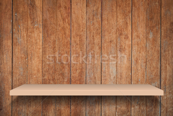Empty brown shelf on old wooden background Stock photo © punsayaporn