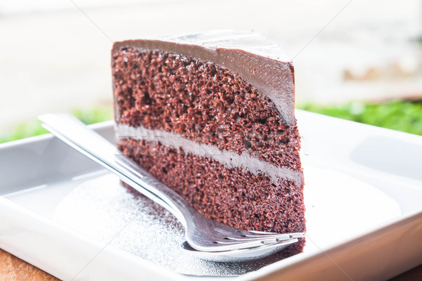 Close up chocolate custard cake serving with spoon and fork  Stock photo © punsayaporn