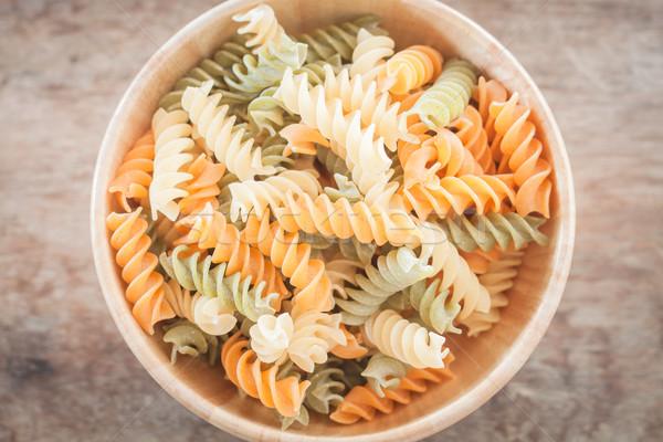 Fusili pasta in wooden plate Stock photo © punsayaporn
