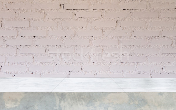 Stock photo: Concrete table top with brick wall