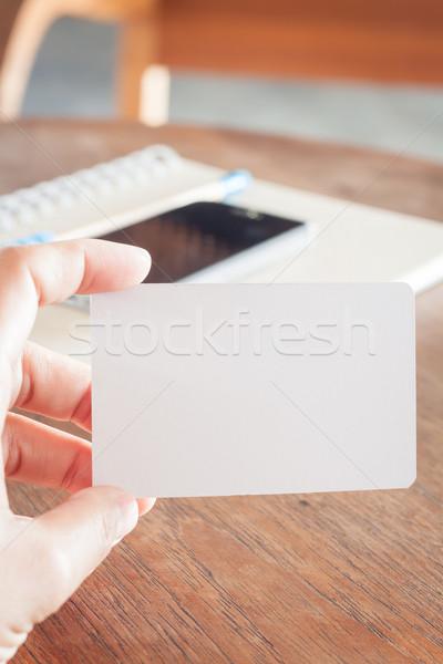 Woman hold blank business cards  Stock photo © punsayaporn