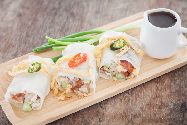 Fresh spring rolls on wooden table Stock photo © punsayaporn