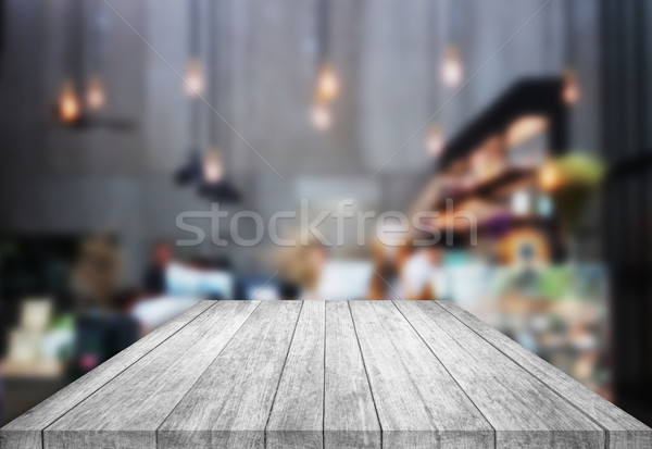 Black and white tabletop wooden with blurred cafe background Stock photo © punsayaporn