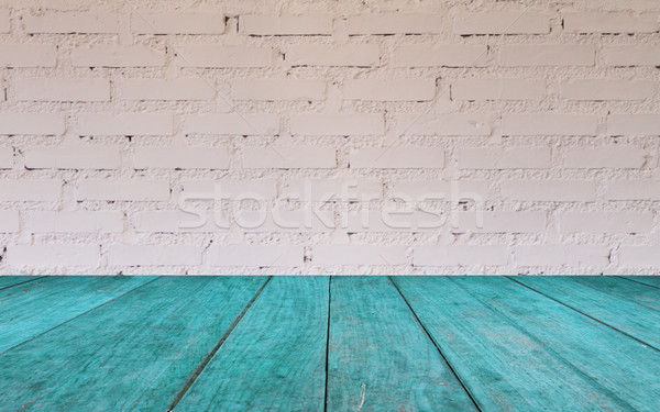 Stock photo: Blue wooden table top with brick wall