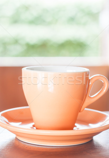 Orange cup of coffee with espresso shot Stock photo © punsayaporn
