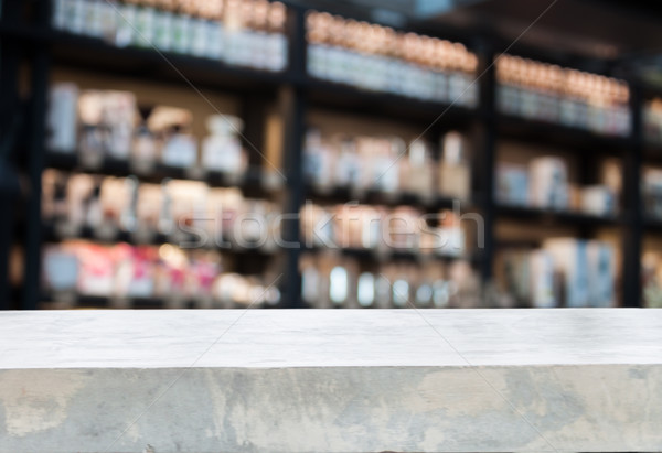 Concrete tabletop with coffee shop blurred background Stock photo © punsayaporn