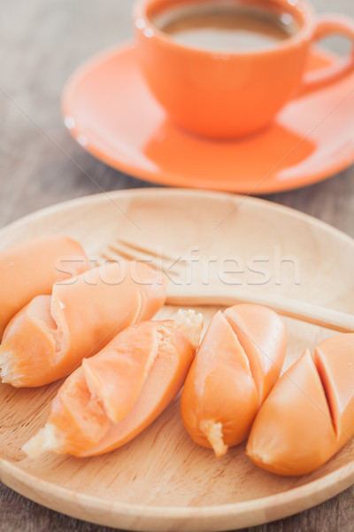 Chicken sausages on wooden plate Stock photo © punsayaporn