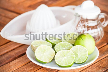 Fresh citrus lime wholes and slice with hand squash tool Stock photo © punsayaporn