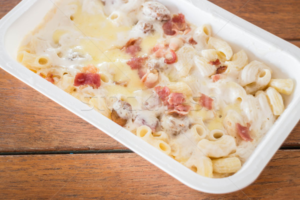 Macaroni cheese with pork ball and ham in the box Stock photo © punsayaporn