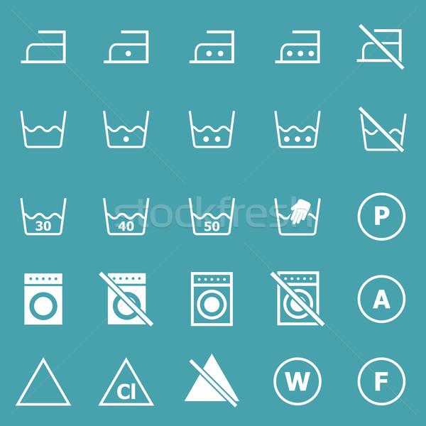 Laundry icons on blue background Stock photo © punsayaporn