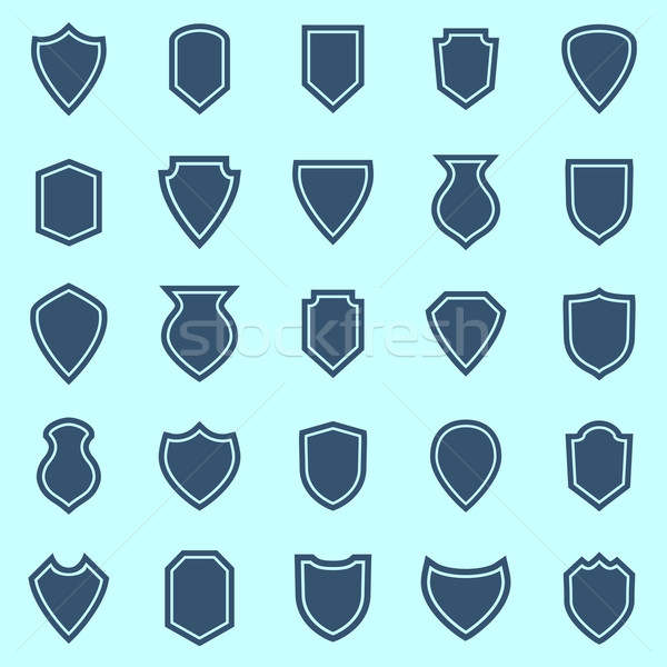 Shield color icons on blue background Stock photo © punsayaporn