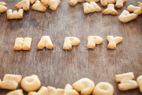 Felice alfabeto biscotto tavolo in legno stock foto Foto d'archivio © punsayaporn