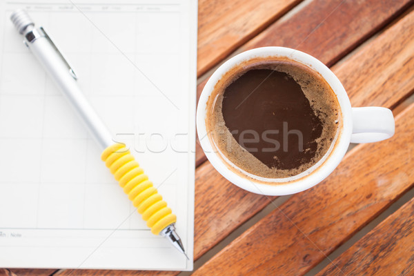 Cup of hot espresso on work wood table Stock photo © punsayaporn